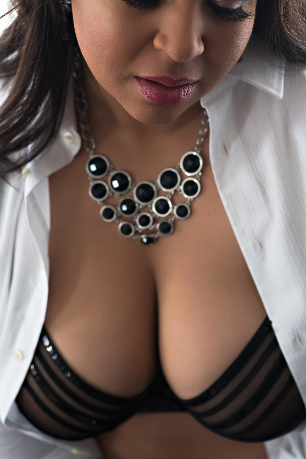 Denver boudoir photo of african american woman wearing black lingerie and unbuttoned dress shirt