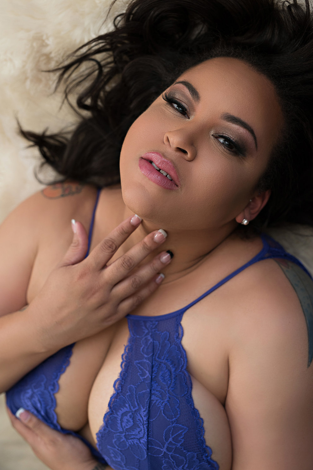 Denver boudoir photo of plus size african american woman in purple lingerie