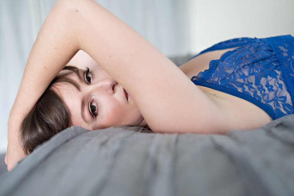 Woman in blue bra Denver boudoir photoshoot