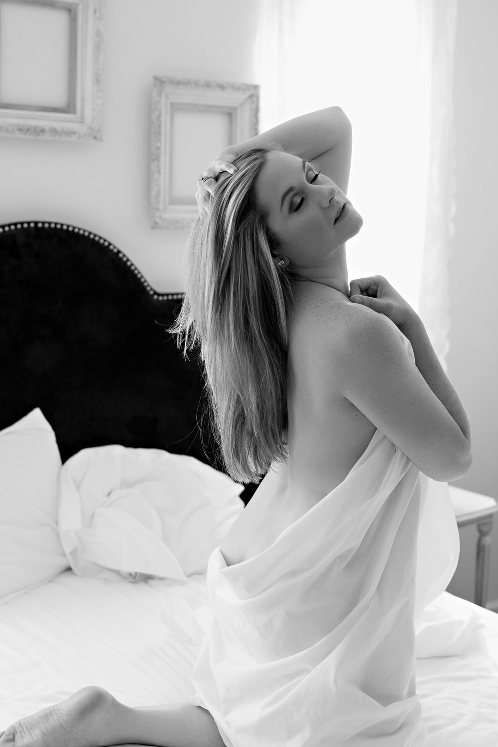 sexy white sheet boudoir session