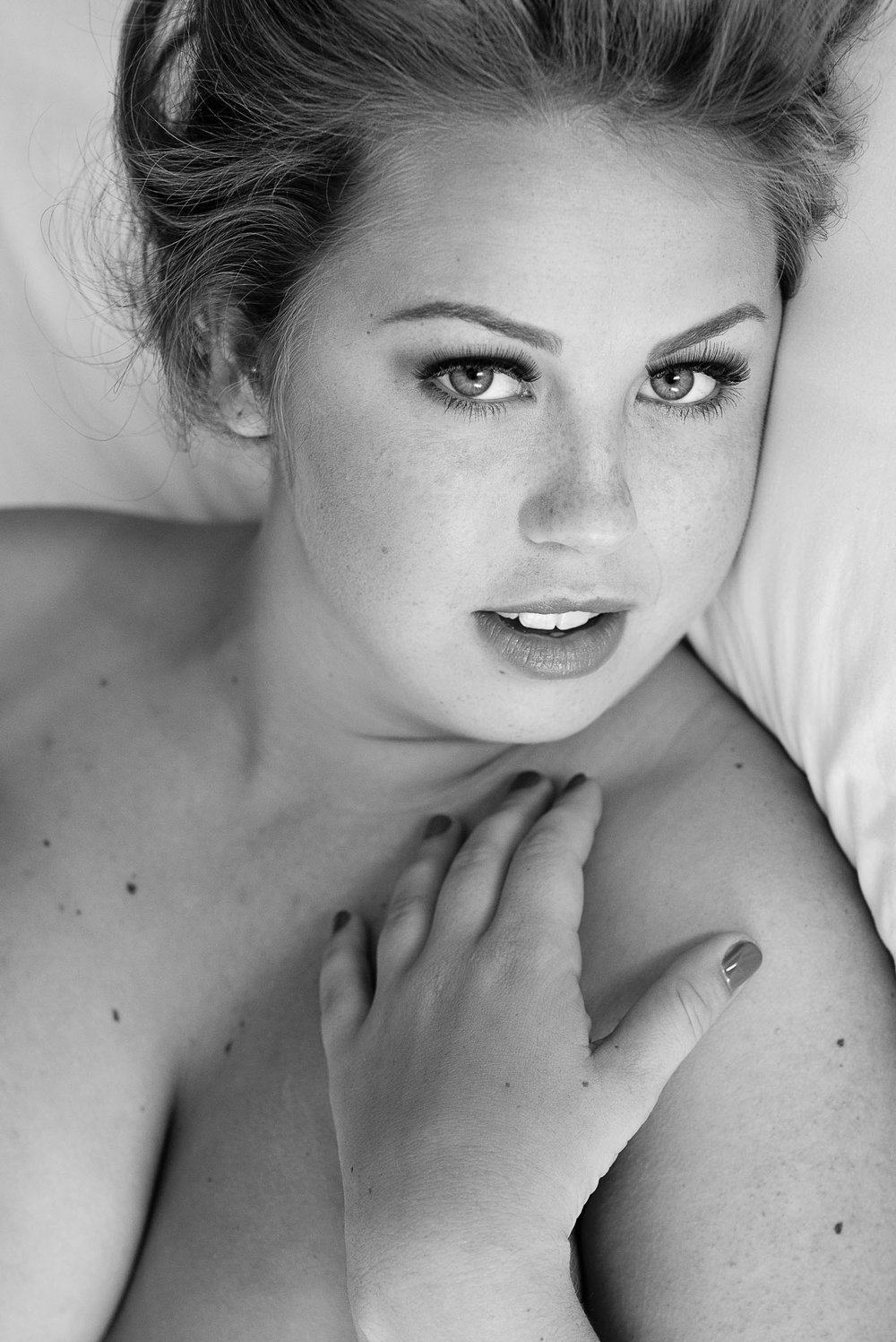 Sultry white sheets boudoir photo shoot