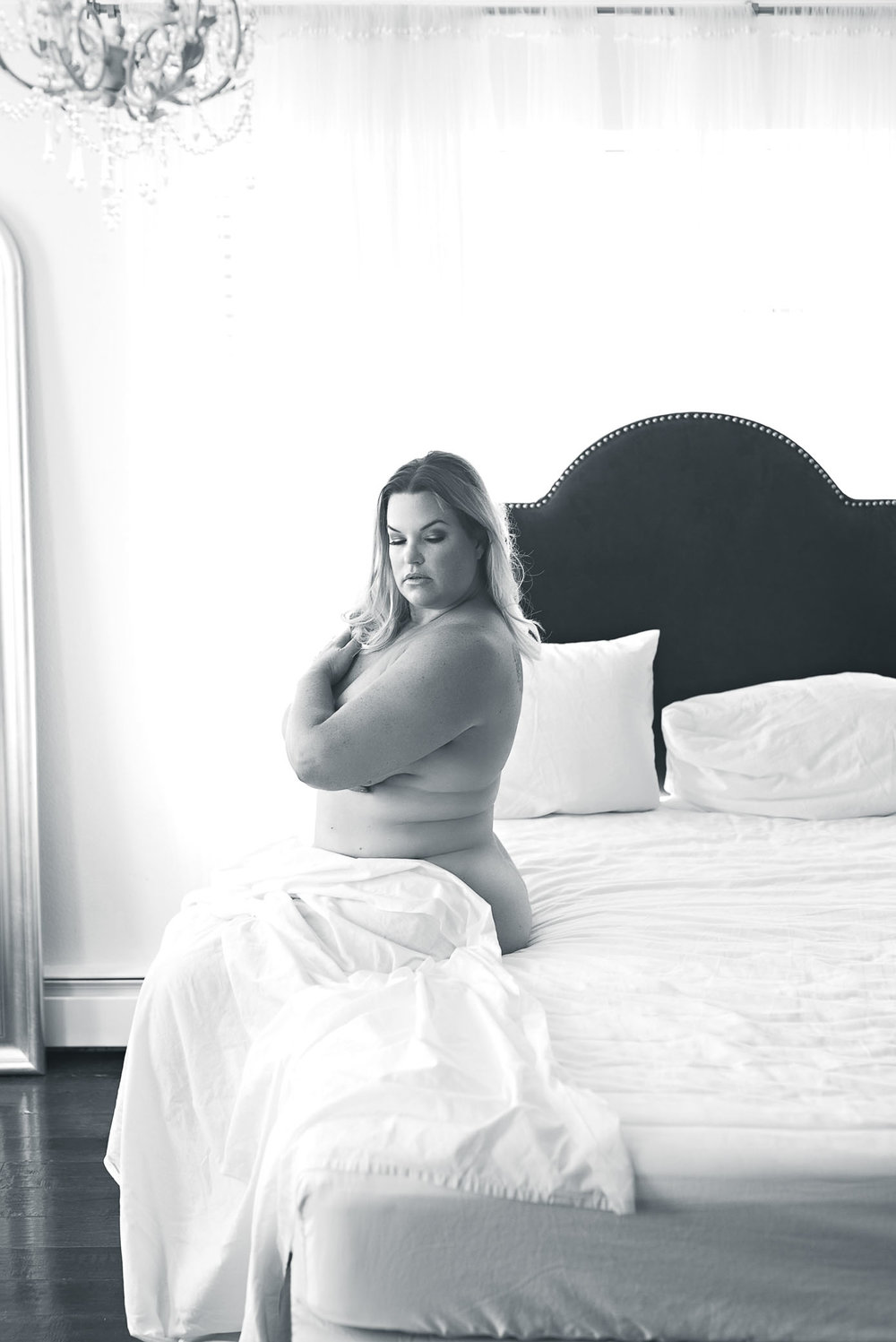black and white photo curvy woman white sheet boudoir session