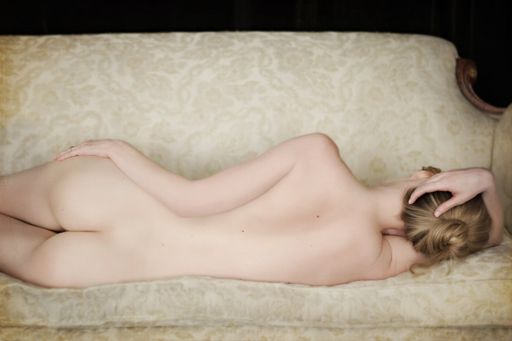 bodyscape photography of blonde woman on couch