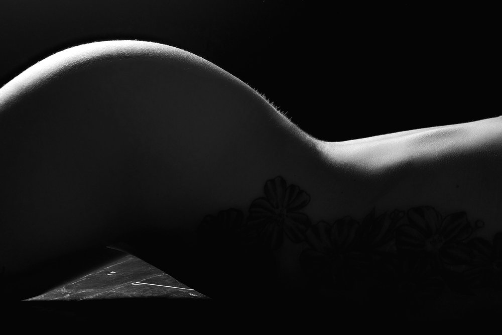 Bodyscape photo of tattooed woman's back