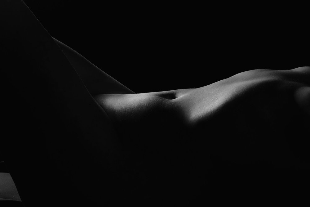 Bodyscape of woman torso in black and white