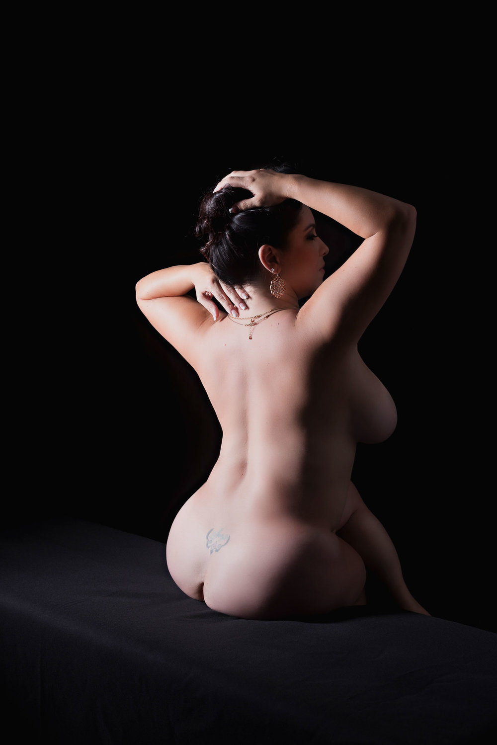 nude art photography of plus-size woman