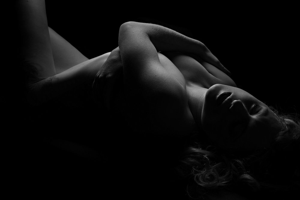 Black and white low key nude photography