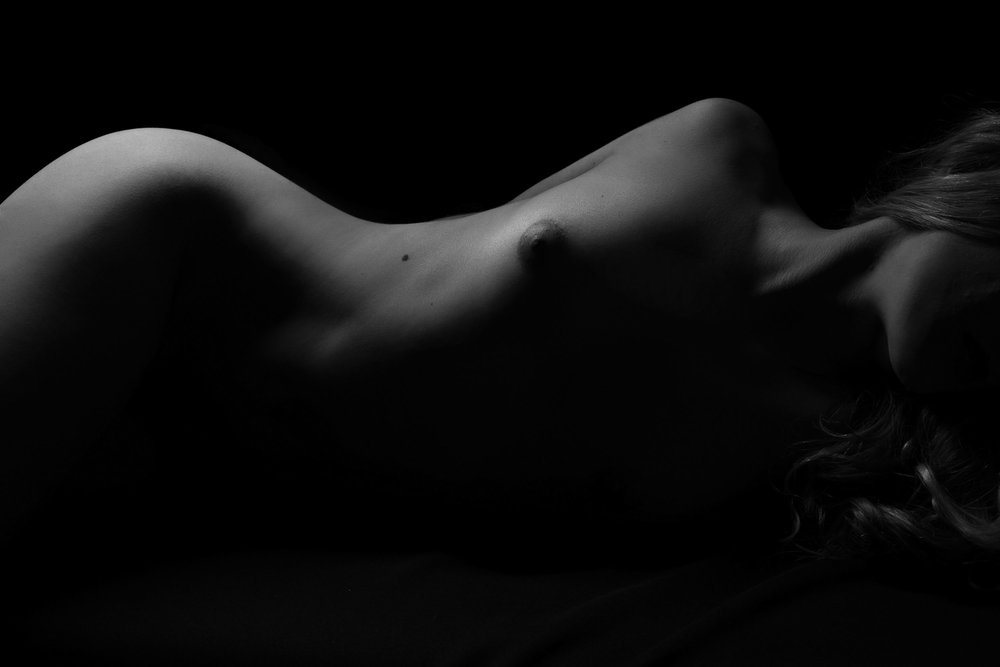 Silhouette figure photo of woman laying down