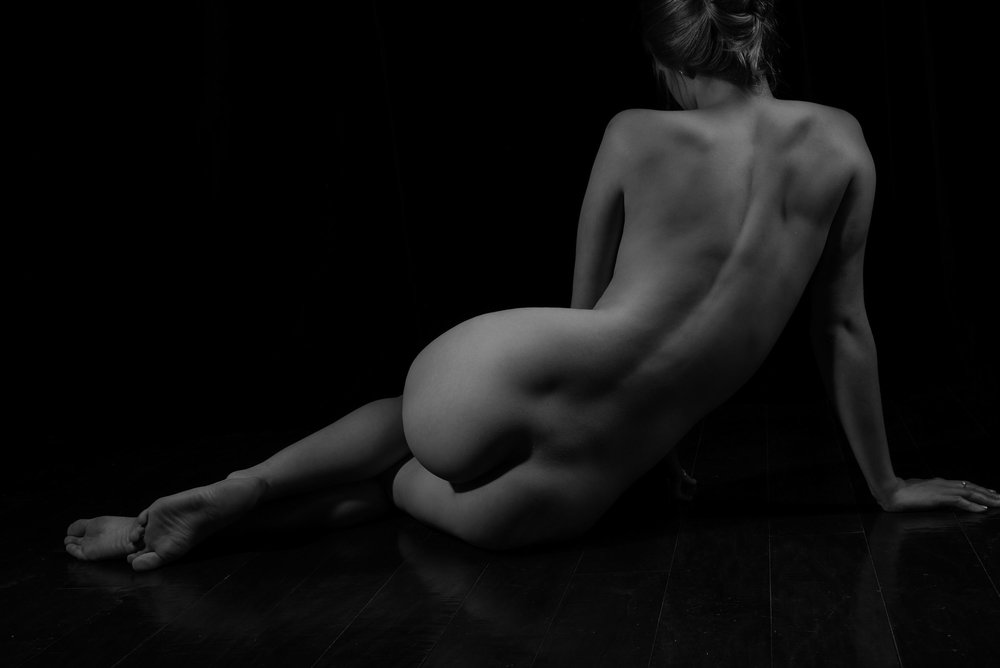 bodyscape photo of womans backside in black and white
