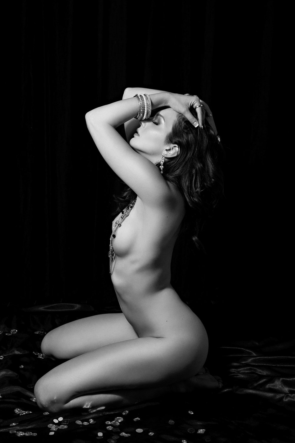 black and white photo of woman on knees art nude