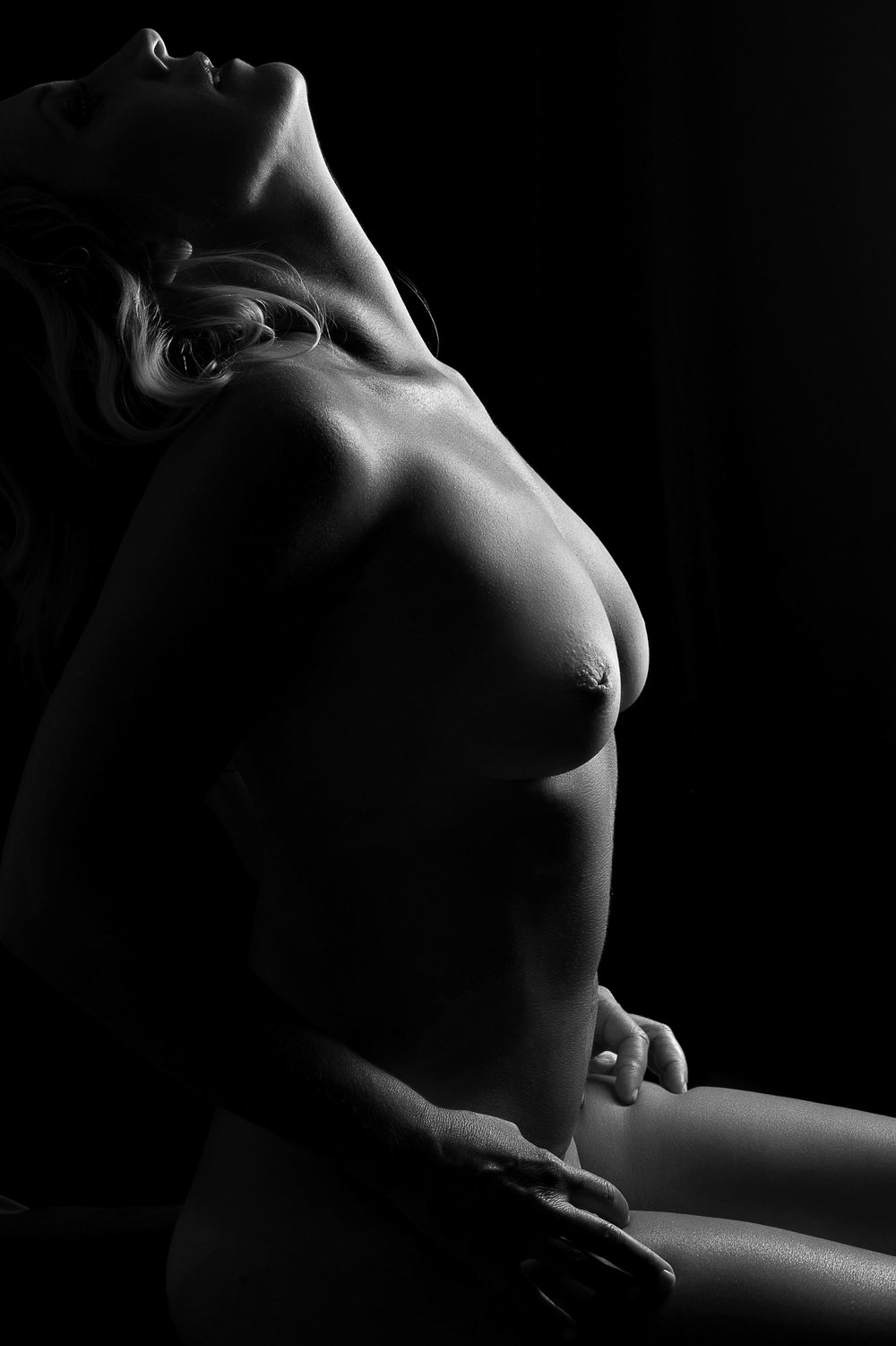 black and white bodyscape of woman from side
