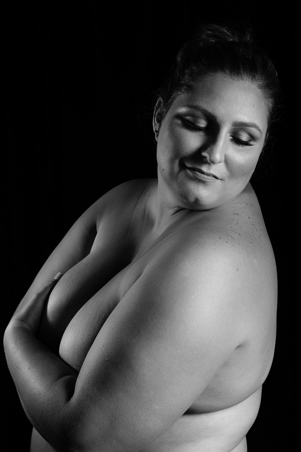 Curvy woman in black and white nude art photography