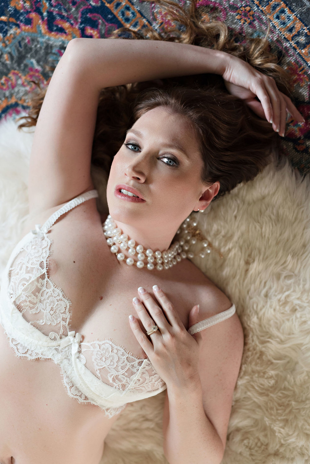 Bridal boudoir photo of brunette woman wearing lace lingerie in Denver Colorado boudoir photographer studio