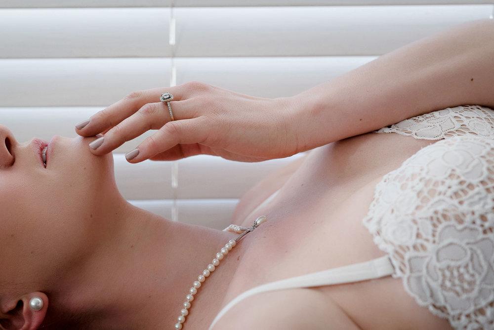 Denver bridal boudoir wedding gift photo of woman wearing white lingerie