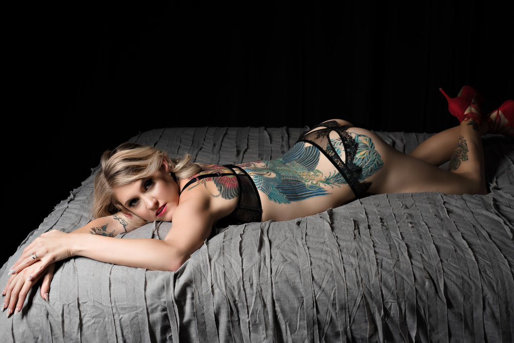 blonde tattooed woman in black lingerie boudoir outfit