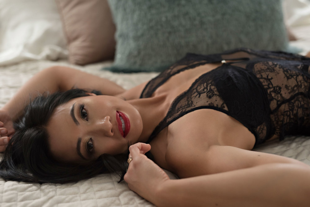 Fit Asian Woman in boudoir pose Denver photographer