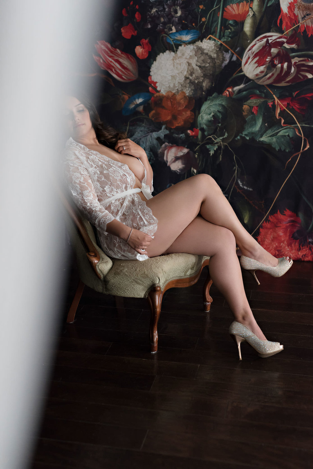 Bridal boudoir photo in white lace robe