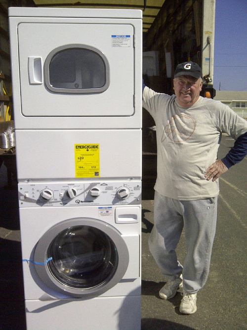 Mr. Hock receives his washer and dryer with grant money.