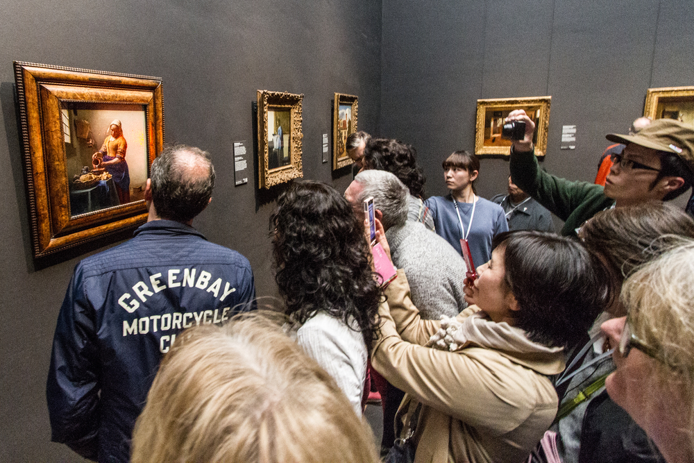 Visitors spend an average of 9 seconds in front of each art work.  Even though the Rijksmuseum offers complete open source access to its collections online, visitors still prefer to capture their own memory of Vermeer's Milkmaid. Makes me wonder what they are really getting from the experience. Image by John Dawson at the Rijksmuseum, Amsterdam 2014.