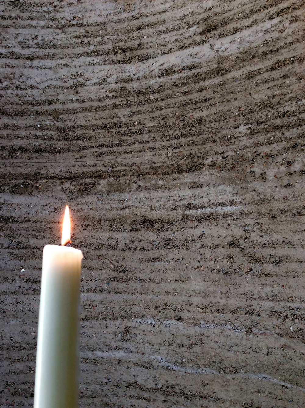 A single candle at the Chapel of Reconciliation gives light to the many lives lost during the era of the Berlin Wall