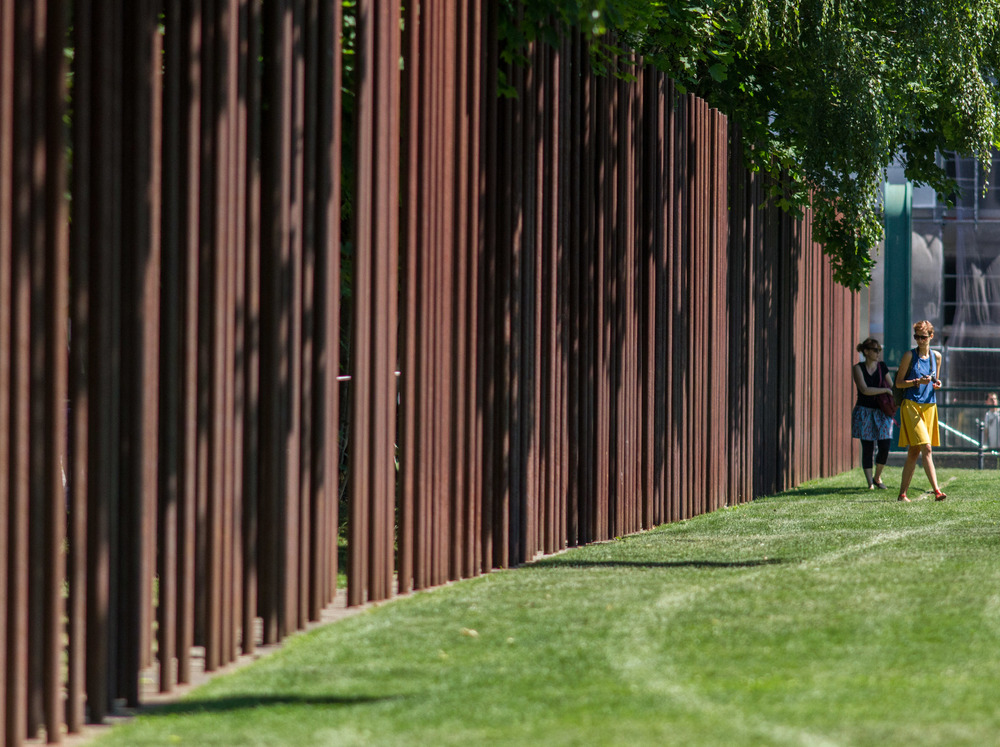 Dual rows of corten steel poles mark the route of the Berlin Wall along Bernauer Strasse. Image by John Dawson