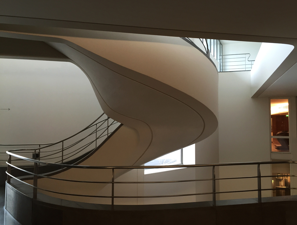 A sweeping stair at the Museum of Asian Art  in Paris  creates a sense of great occasion. The curving structure offers views down into the grand hall and into the beautifully-sequenced exhibition spaces on the upper levels.
