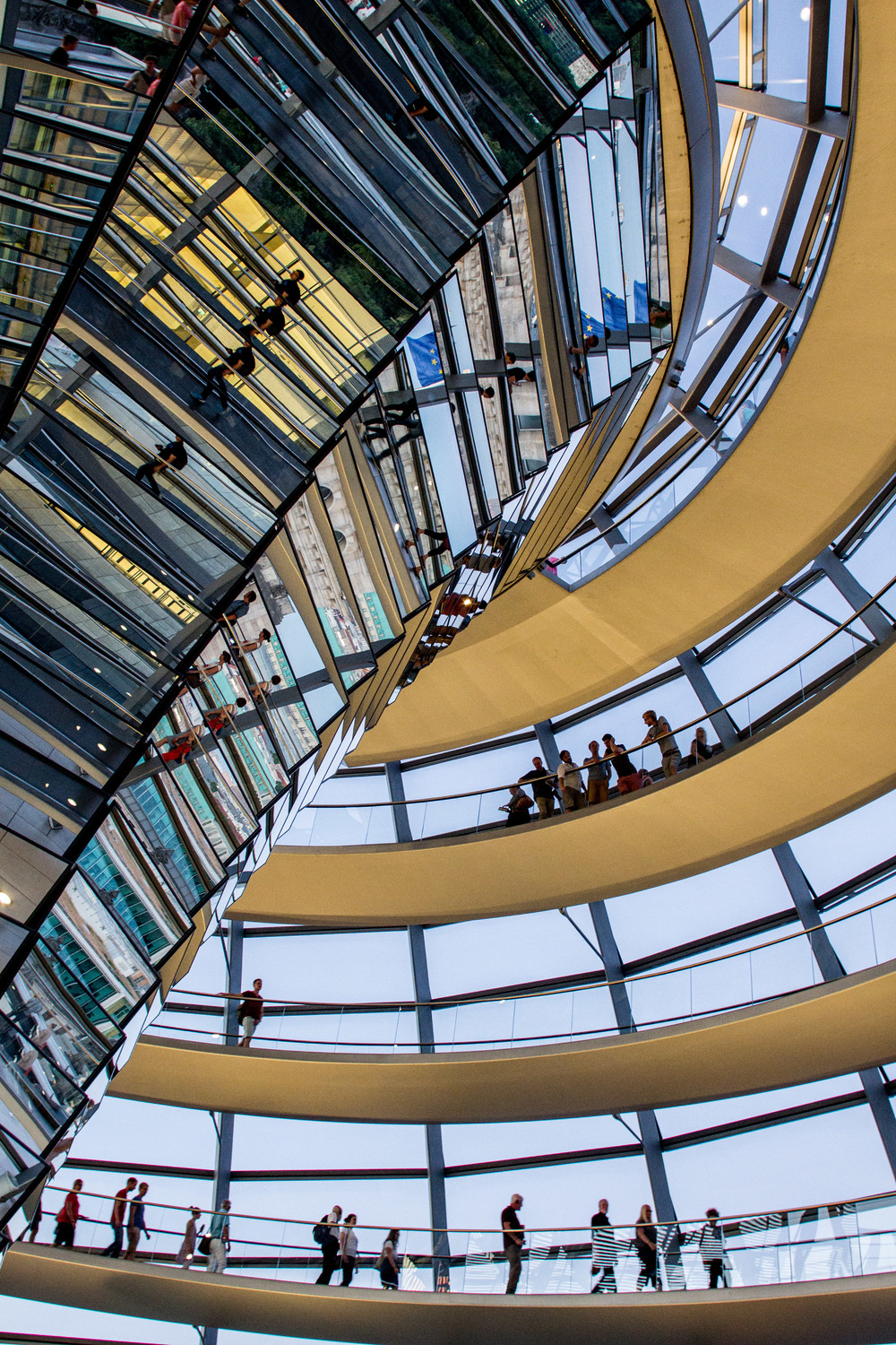 The entire structure of the Reichstag Dome   serves   as a stairway   up to heaven and down to reunification and democracy. Architecture by Norman Foster. Image by John Dawson