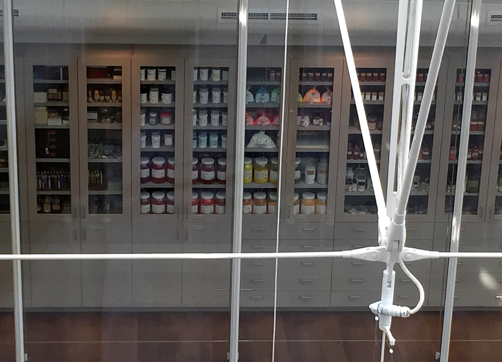 Paint pigment store for use by conservators is on view and forms part of the aesthetic of the museum