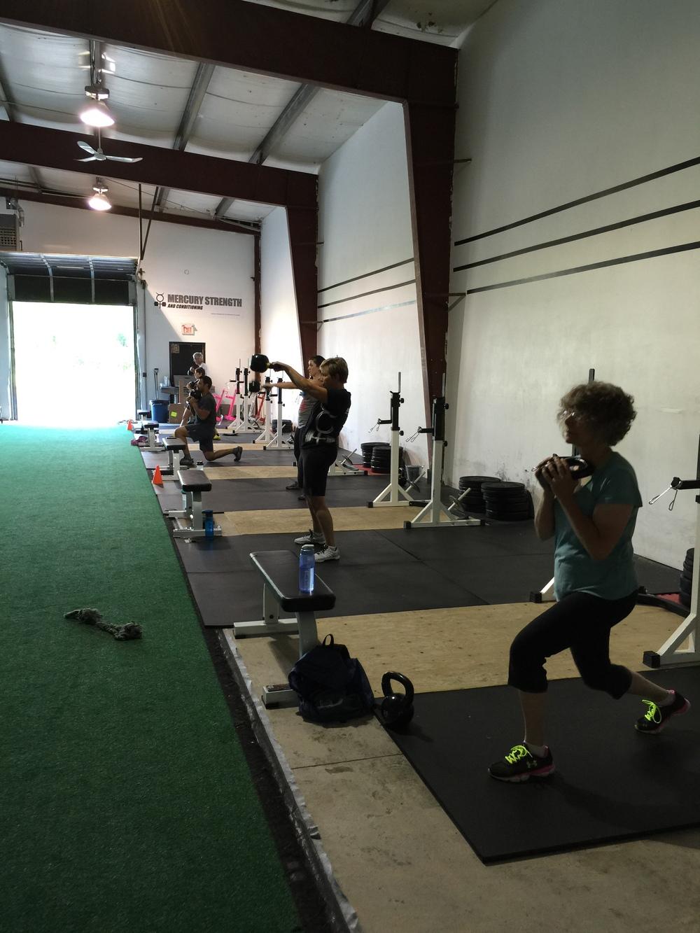 gym-fitness-training-kingston-lunge-kettlebell swing