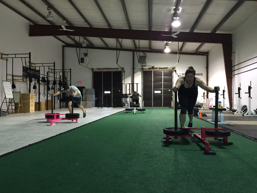 Jeff, Andrew, and Morgan with some prowler sprints after some heavy deadlifts.