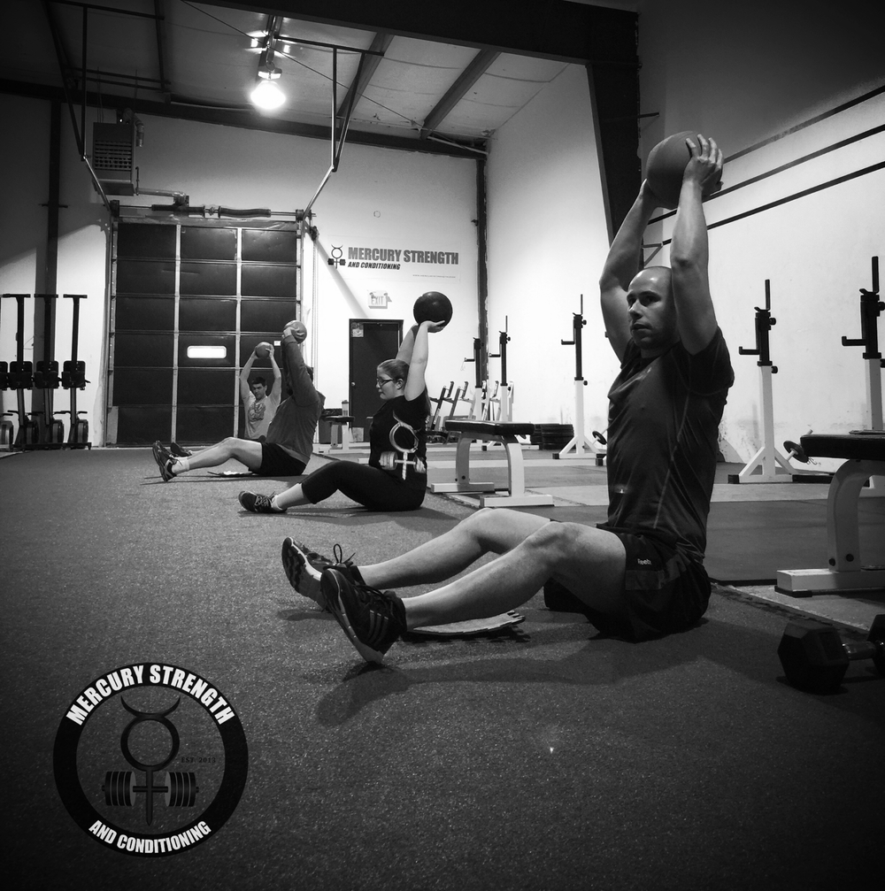 Mike, Hannah, Craig, and Jeff with overhead ball holds really firing up those shoulders