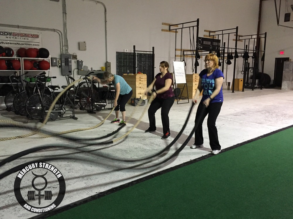 Sandra, Vero, and Shelley with some battle rope action first thing in the morning. Have fun washing your hair!