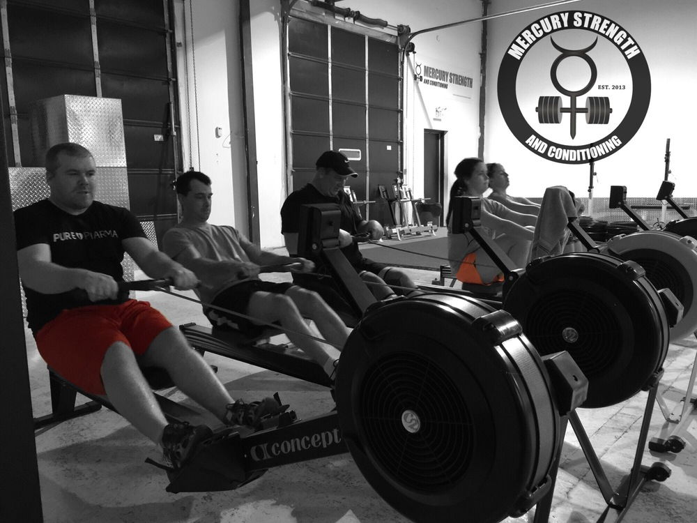 Alec, Nick, Pete, Syd, and Kelsi getting some Tabata rowing in during last night's session.