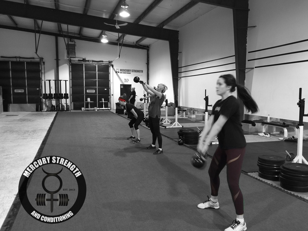 16:45 class getting some kettlebell swings in.