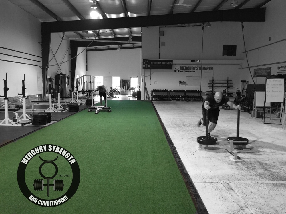 Jeff and Sean sprinting with the prowler.