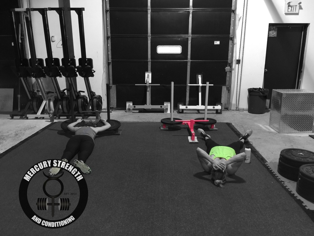 After doing some 5RM squats, Rachael and Kelly feel the effects of the prowler.