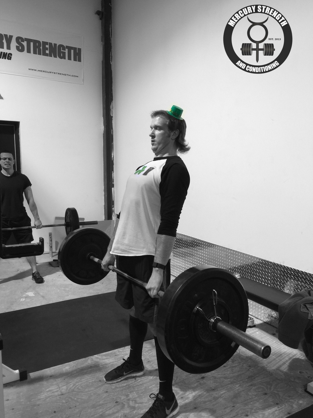Lucas sporting the St. Patty's Day garb while cranking out one of his 20 deadlifts.