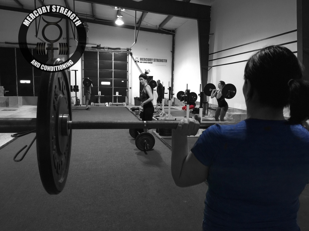 Some of yesterday's 09:30 crew cranking out some power cleans, push presses, and front squats