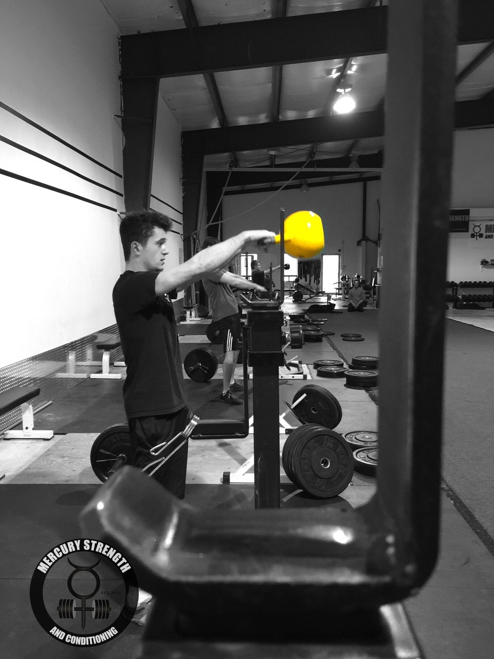 Bryce, our SLC student, getting some KB swings done.