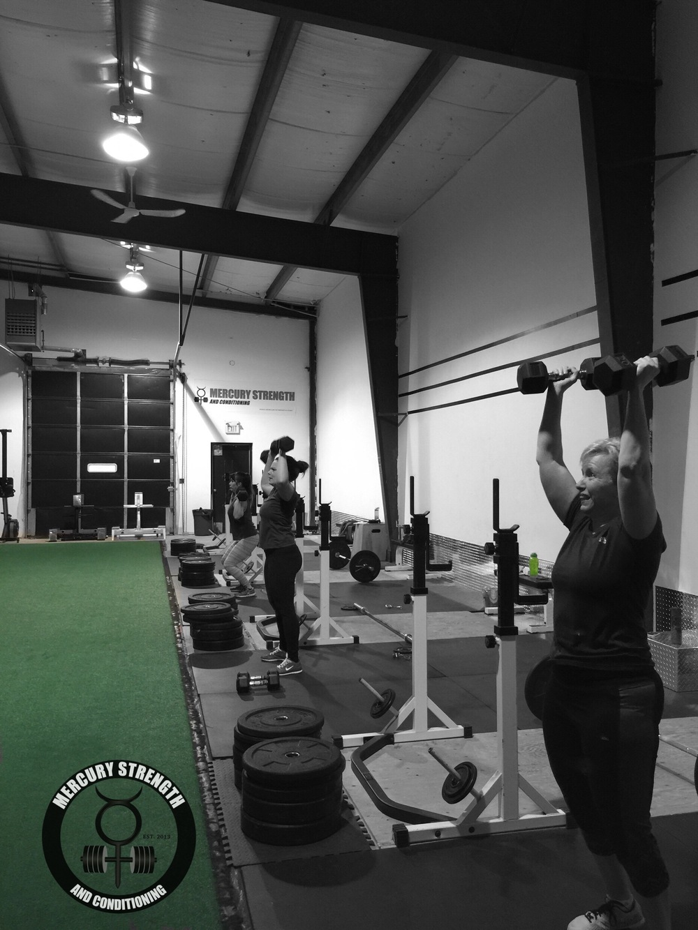 Teresa, Michelle, and Amelia cranking out some DB push presses.