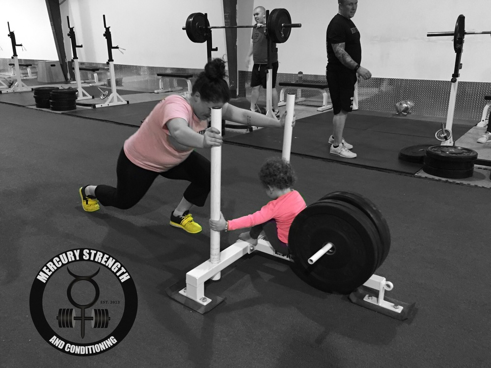Catherine getting a little encouragement during some prowler lunges.