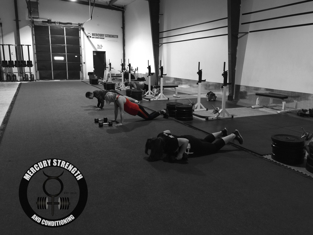 Some of the 16:45 crew with some push-ups during the death by shoulder taps/push-ups.