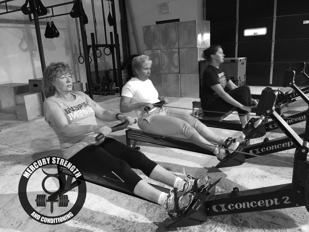 Shelley, Teresa, and Meg pulling hard on the rowers.