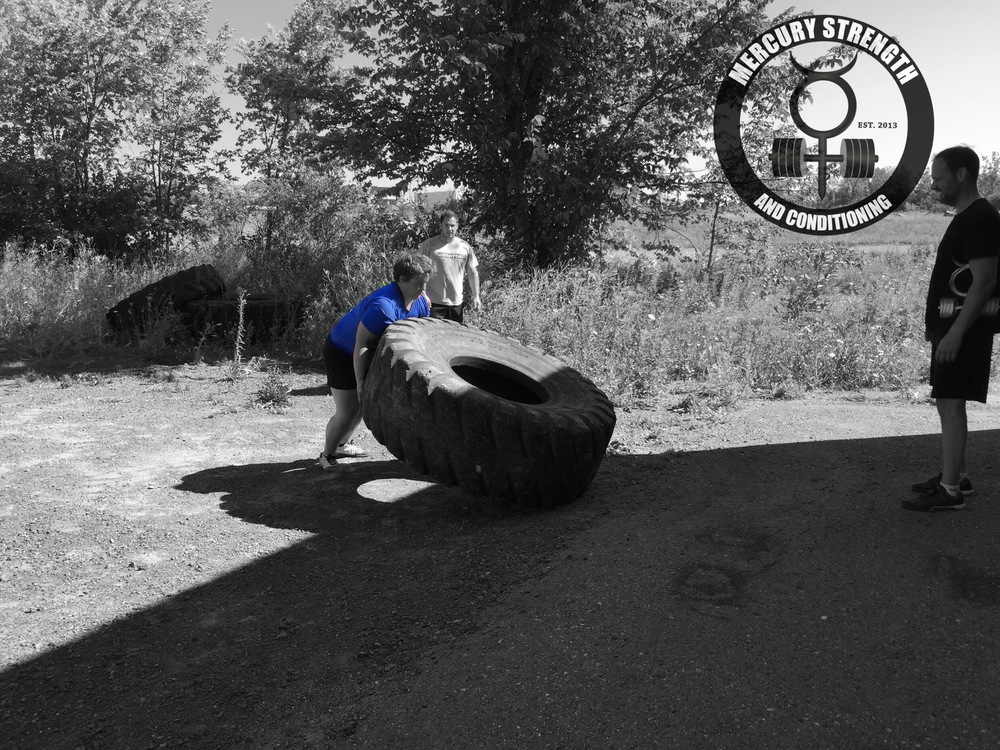 "Shannon flipping our 550 pound tire. ""Light weight! Light weight!"""