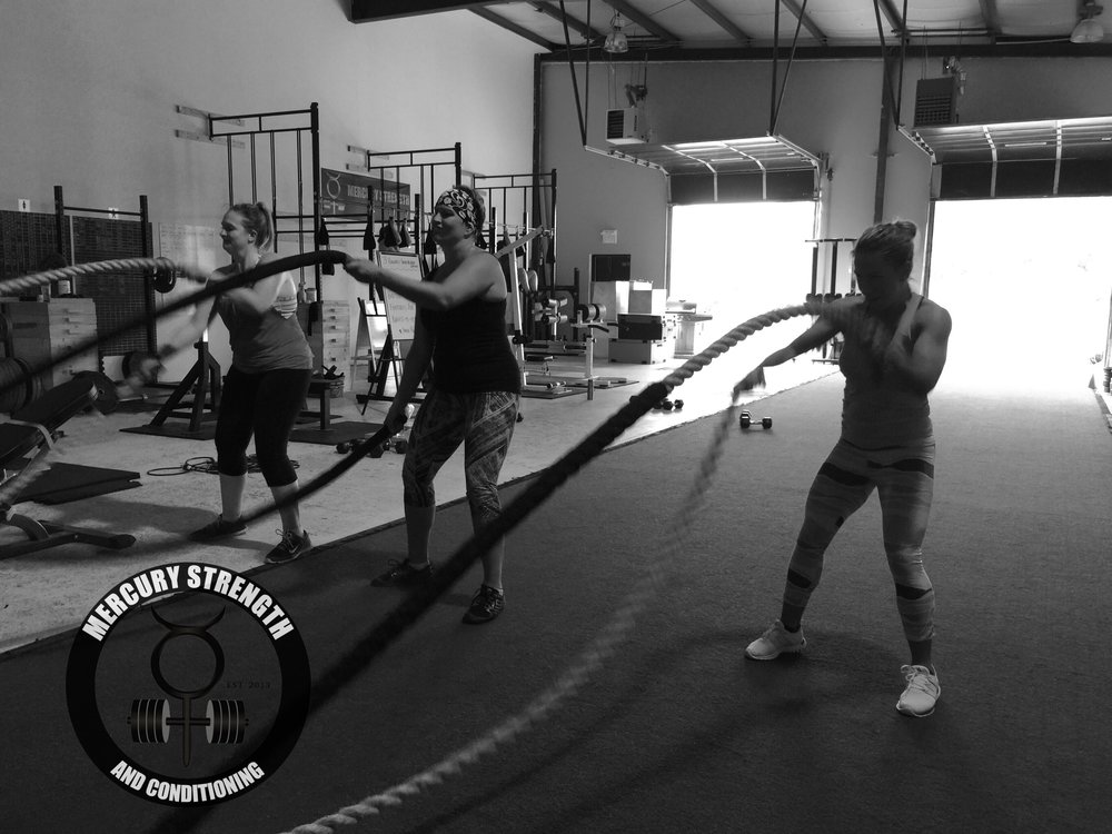 New members Erin and Jo and kinda sorta new member Paula burning up the shoulders with some battle ropes yesterday!