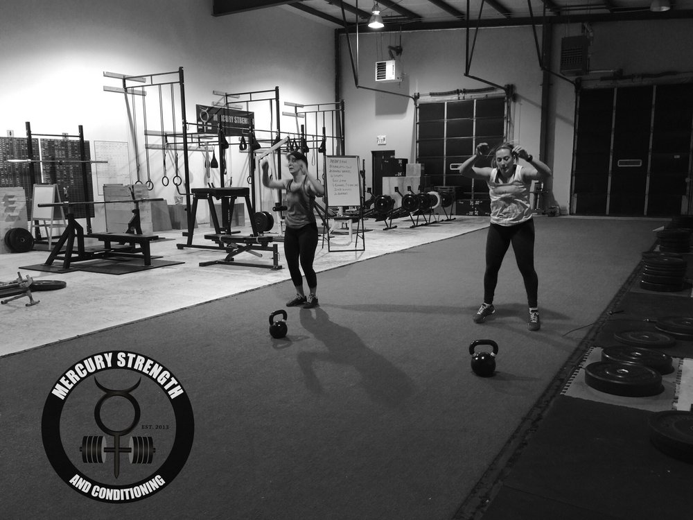 Shawna and Jess going head to head during the KB swing/burpee workout from last Friday.