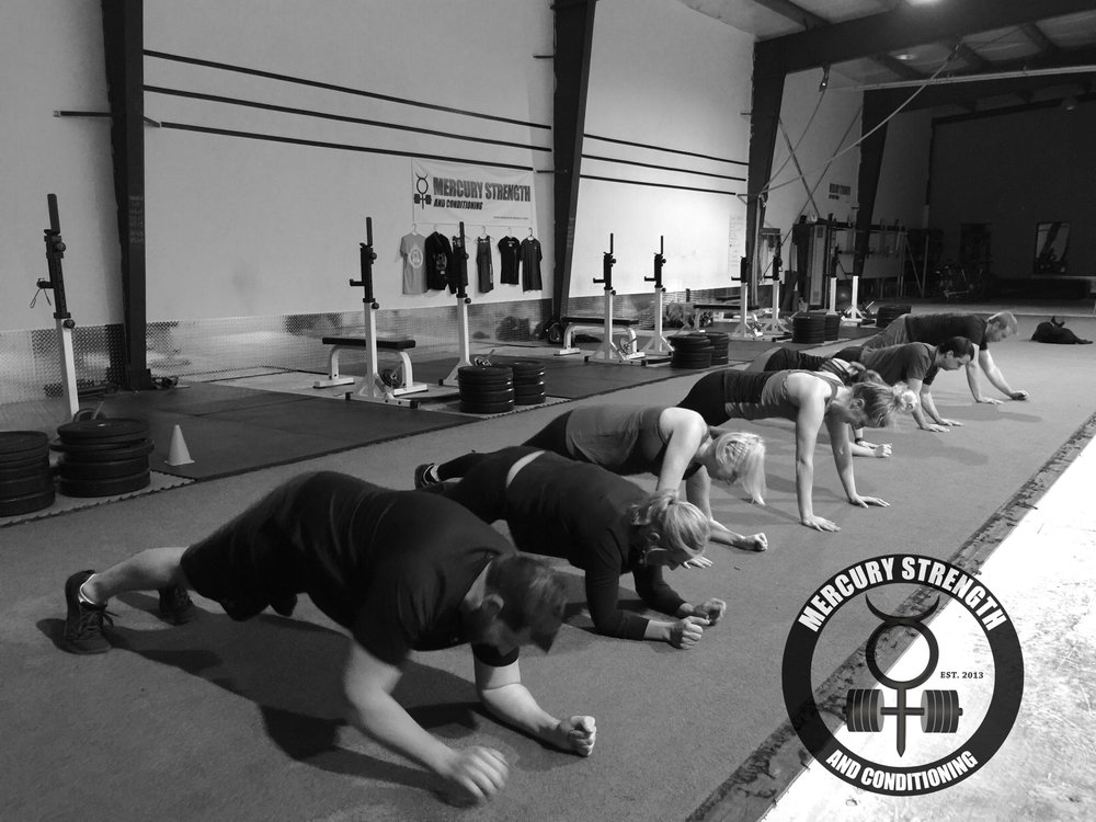 The 16:45 crew pounding through some plank-ups during Monday's workout.
