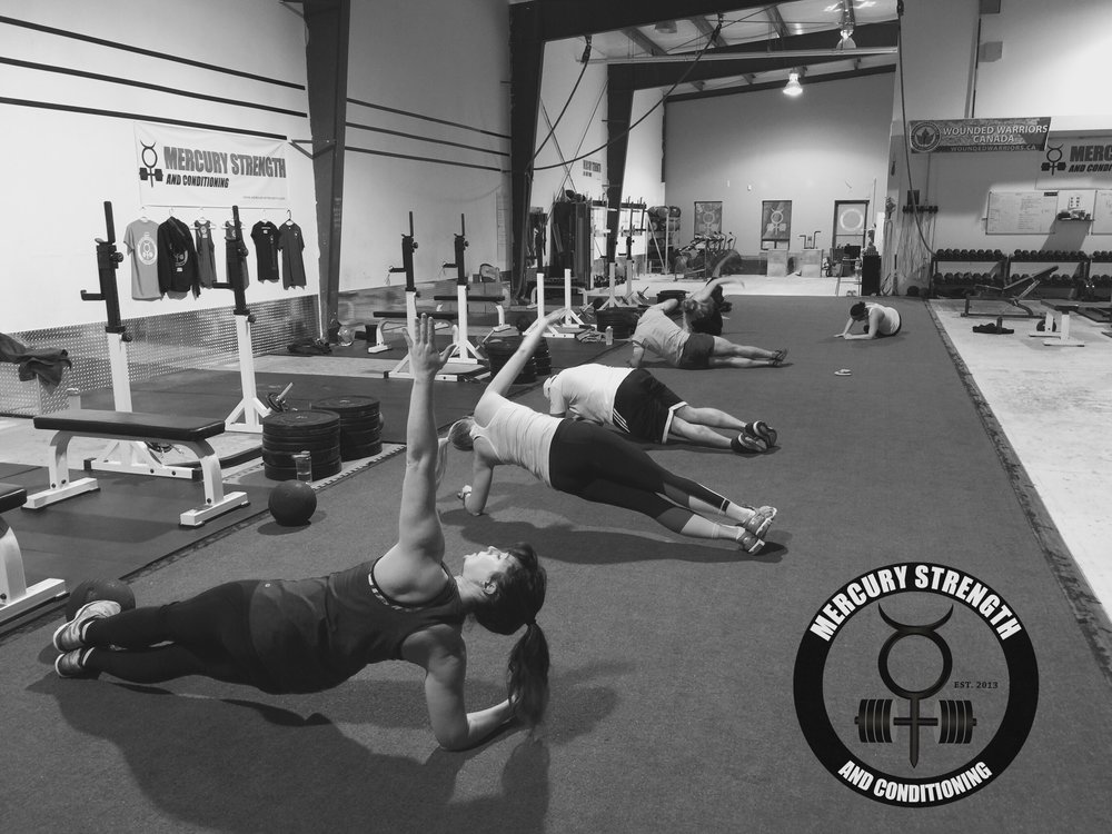gym-fitness-training-bootcamp-crossfit-kingston-kids-mercury-strength-conditioning-athlete-side plank-rotations