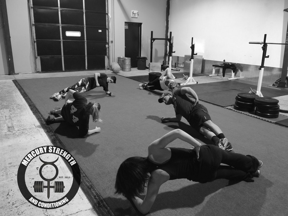 Heather, Colby, Julie, Michelle, and Kelsi with some side plank dips