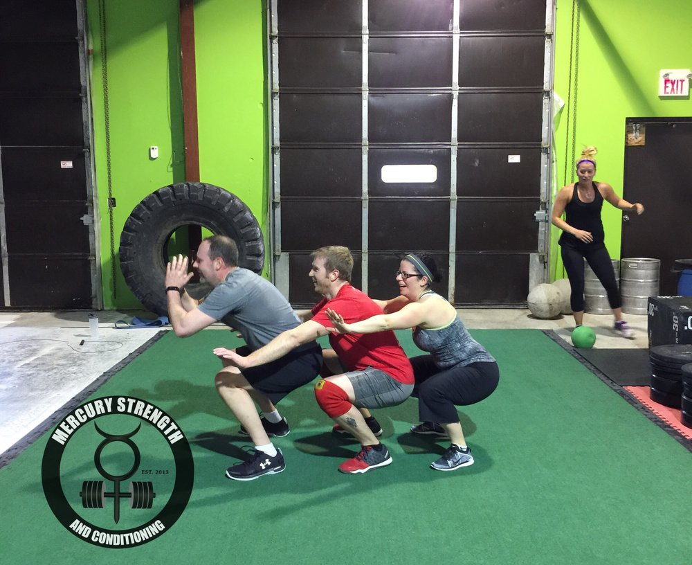 Andrew, Lucas, and Jen having some fun on Saturday with the squat train
